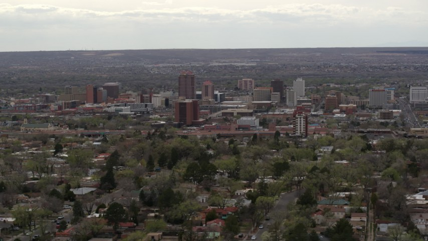 5.7K stock footage aerial video of the city's high-rise buildings seen while passing by neighborhood, Downtown Albuquerque, New Mexico Aerial Stock Footage | DX0002_126_039