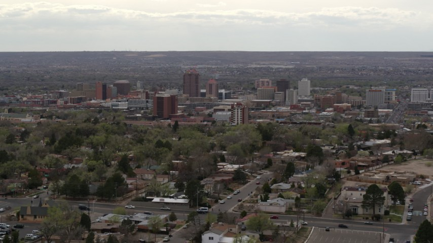 5.7K stock footage aerial video wide view of city's high-rises seen while passing by neighborhood, Downtown Albuquerque, New Mexico Aerial Stock Footage | DX0002_126_040