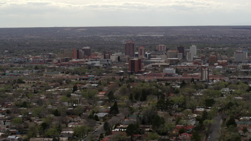 5.7K stock footage aerial video wide view of city's high-rises seen while flying by neighborhood, Downtown Albuquerque, New Mexico Aerial Stock Footage | DX0002_126_041