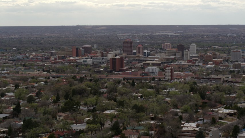 5.7K stock footage aerial video wide view of city's high-rises seen from neighborhood, Downtown Albuquerque, New Mexico Aerial Stock Footage | DX0002_126_042
