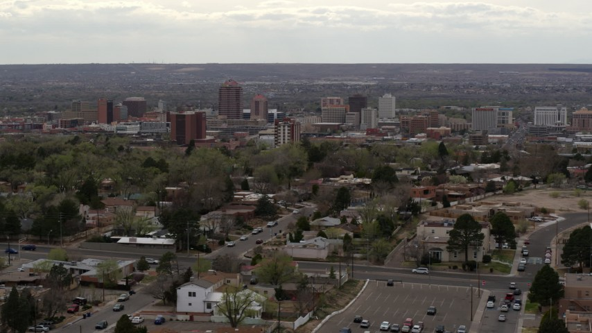 5.7K stock footage aerial video wide view of city's high-rises seen while slowly passing homes, Downtown Albuquerque, New Mexico Aerial Stock Footage | DX0002_126_044