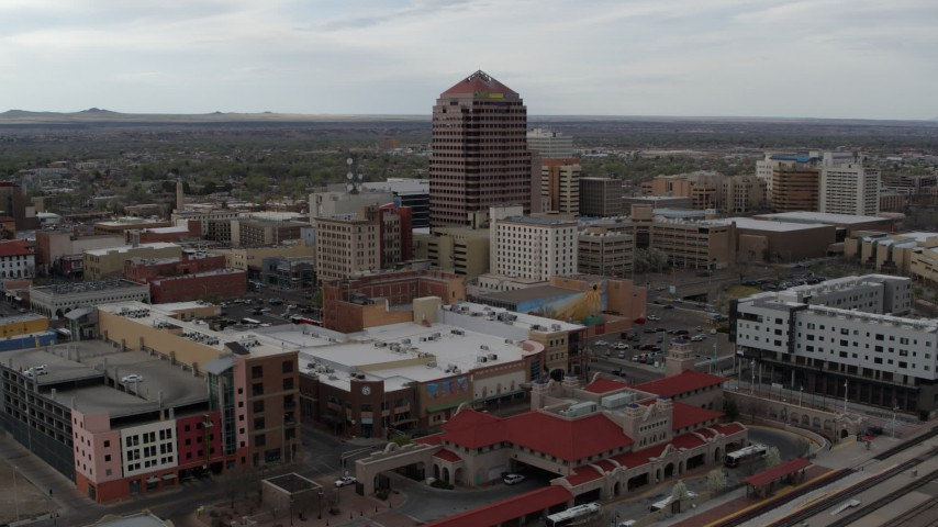 5.7K stock footage aerial video flying away from Albuquerque Plaza high-rise and neighboring city buildings, Downtown Albuquerque, New Mexico Aerial Stock Footage | DX0002_127_006
