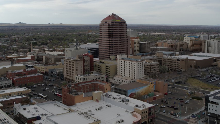 5.7K stock footage aerial video wide orbit of Albuquerque Plaza high-rise and neighboring city buildings, Downtown Albuquerque, New Mexico Aerial Stock Footage | DX0002_127_008