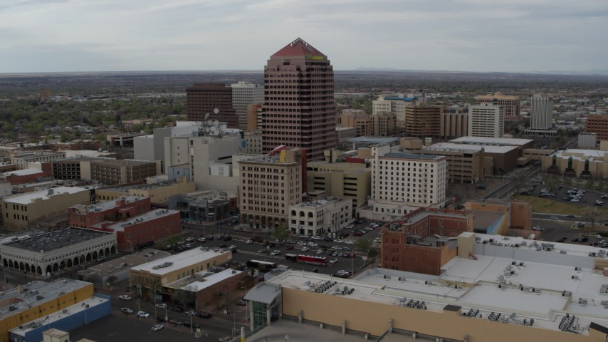 5.7K stock footage aerial video circling Albuquerque Plaza and neighboring city buildings, Downtown Albuquerque, New Mexico Aerial Stock Footage | DX0002_127_009