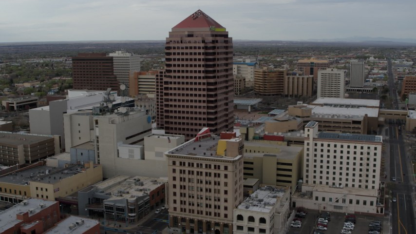 5.7K stock footage aerial video fly toward Albuquerque Plaza and neighboring city buildings, Downtown Albuquerque, New Mexico Aerial Stock Footage | DX0002_127_010