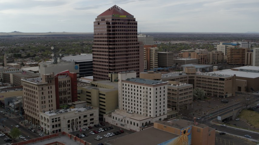 5.7K stock footage aerial video orbit and fly away from Albuquerque Plaza and neighboring city buildings, Downtown Albuquerque, New Mexico Aerial Stock Footage DX0002_127_011 | Axiom Images
