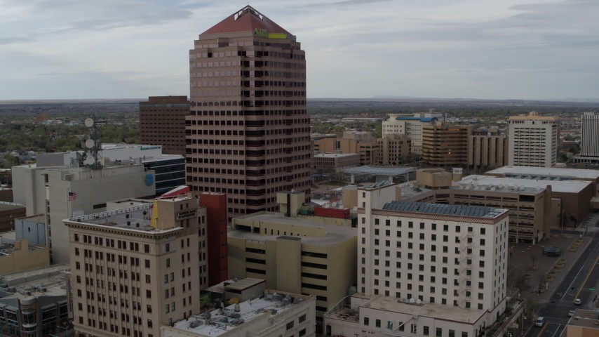 5.7K stock footage aerial video of Albuquerque Plaza and other city buildings during descent, Downtown Albuquerque, New Mexico Aerial Stock Footage | DX0002_127_013