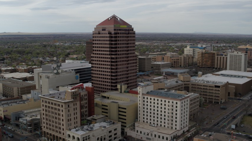 5.7K stock footage aerial video approach and orbit Albuquerque Plaza and neighboring city buildings, Downtown Albuquerque, New Mexico Aerial Stock Footage | DX0002_127_015