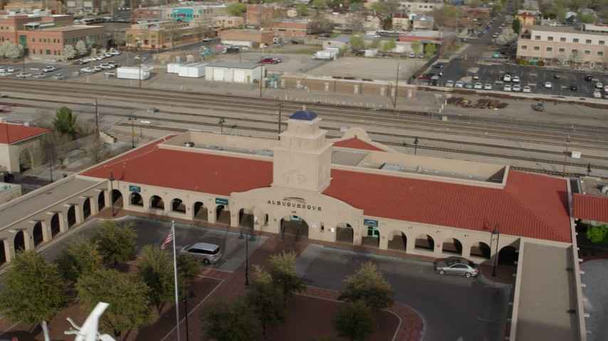 5.7K stock footage aerial video of the Albuquerque train station, Downtown Albuquerque, New Mexico Aerial Stock Footage | DX0002_127_016