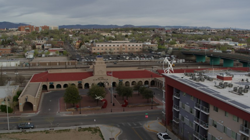5.7K stock footage aerial video reverse view of the entrance of the Albuquerque train station, Downtown Albuquerque, New Mexico Aerial Stock Footage | DX0002_127_022