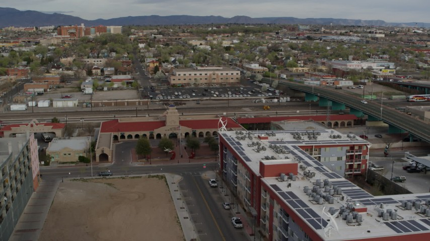 5.7K stock footage aerial video orbit and stationary view of the entrance of the Albuquerque train station, Downtown Albuquerque, New Mexico Aerial Stock Footage | DX0002_127_023