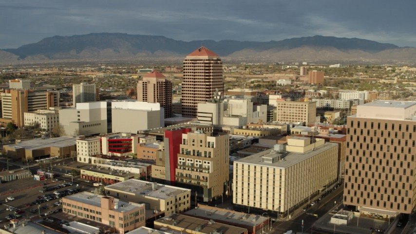 5.7K stock footage aerial video fly away from Albuquerque Plaza towering over city buildings, Downtown Albuquerque, New Mexico Aerial Stock Footage | DX0002_127_027