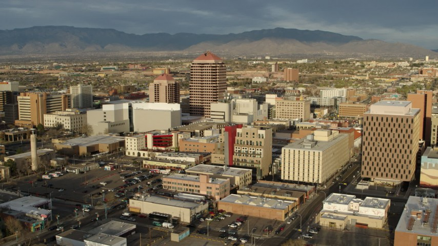 5.7K stock footage aerial video of flying by Albuquerque Plaza towering over city buildings, Downtown Albuquerque, New Mexico Aerial Stock Footage | DX0002_127_028