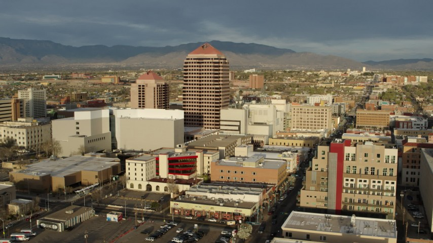 5.7K stock footage aerial video wide orbit of Albuquerque Plaza towering over city buildings, Downtown Albuquerque, New Mexico Aerial Stock Footage DX0002_127_030