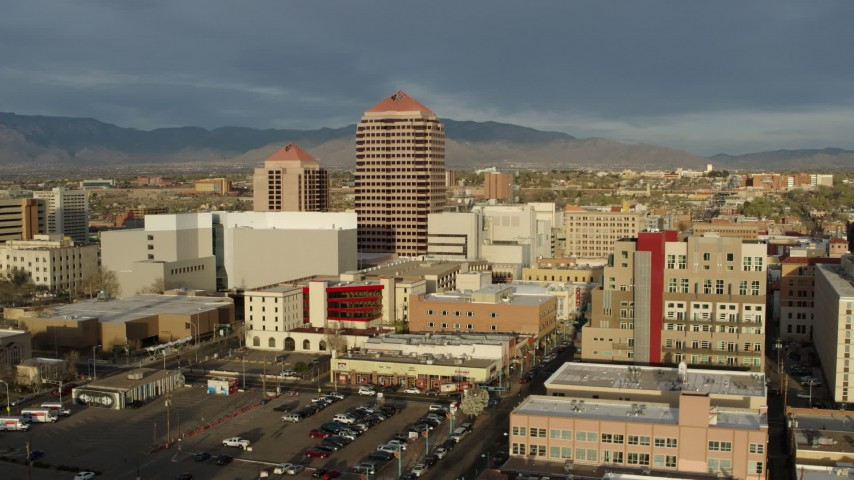5.7K stock footage aerial video wide orbit of Albuquerque Plaza high-rise towering over city buildings, Downtown Albuquerque, New Mexico Aerial Stock Footage | DX0002_127_031