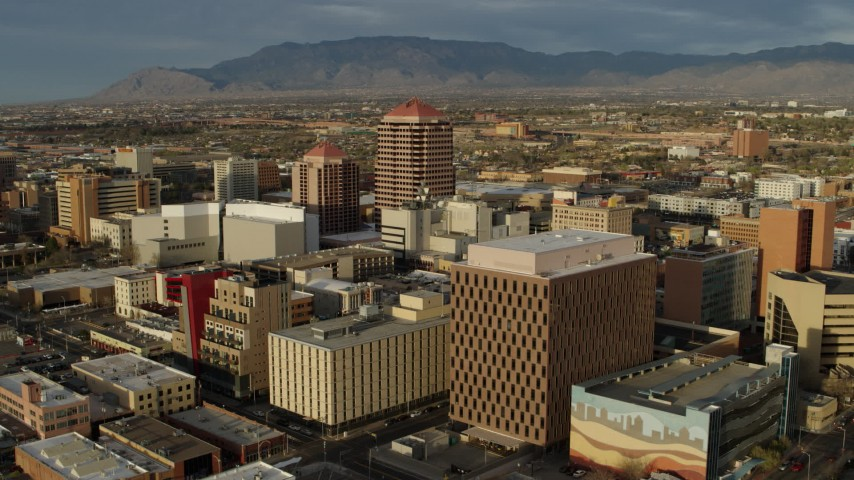 5.7K stock footage aerial video flyby federal building, focus on Albuquerque Plaza high-rise, Downtown Albuquerque, New Mexico Aerial Stock Footage | DX0002_127_033