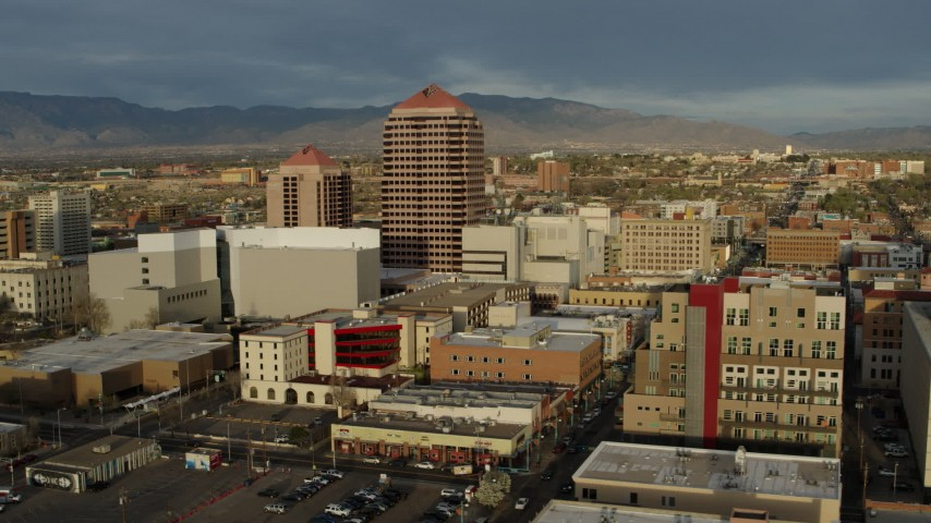 5.7K stock footage aerial video descend and orbit office high-rise and city buildings, Downtown Albuquerque, New Mexico Aerial Stock Footage | DX0002_127_035