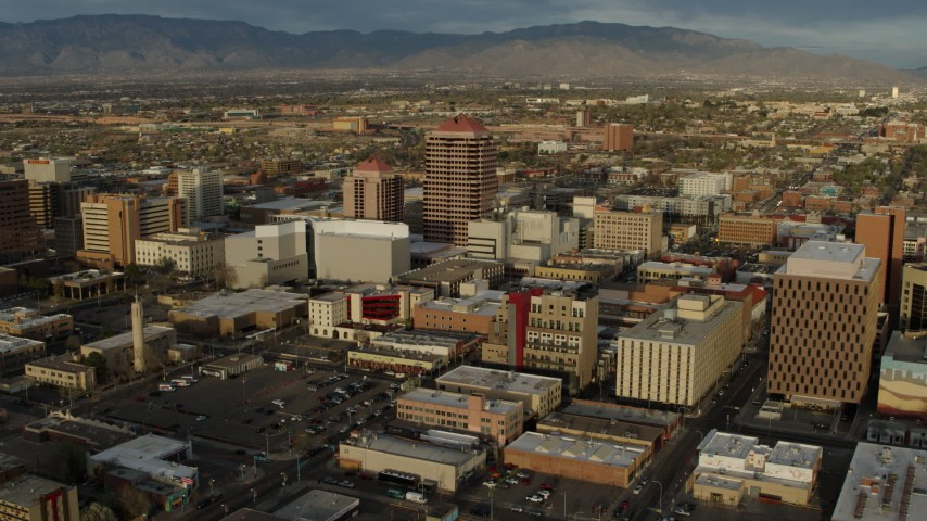 5.7K stock footage aerial video a reverse view of office high-rise and city buildings, Downtown Albuquerque, New Mexico Aerial Stock Footage | DX0002_127_036