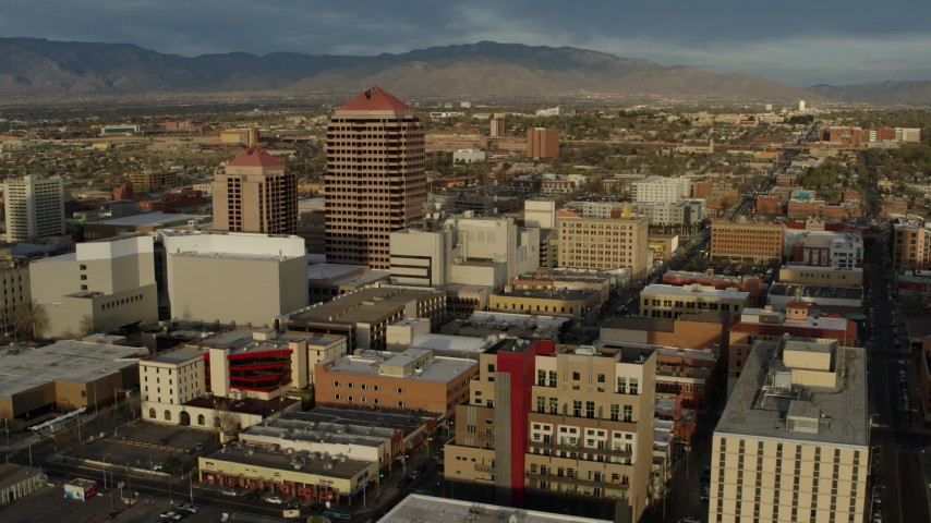 5.7K stock footage aerial video of approaching office high-rise and city buildings, Downtown Albuquerque, New Mexico Aerial Stock Footage | DX0002_127_037