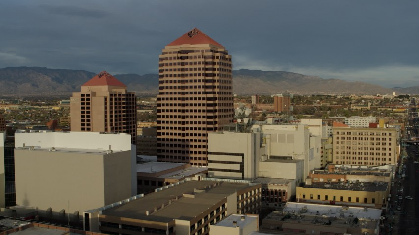 5.7K stock footage aerial video approach office high-rise for stationary view, Downtown Albuquerque, New Mexico Aerial Stock Footage | DX0002_127_038