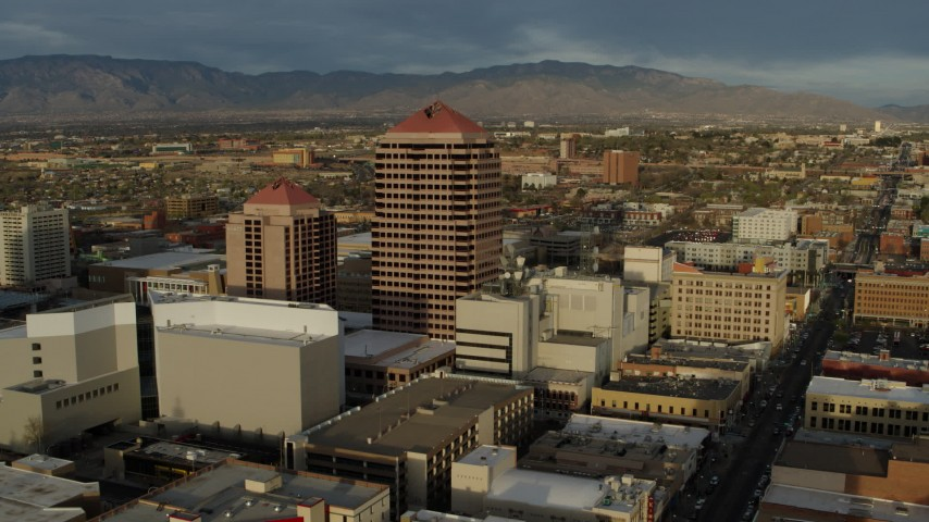 5.7K stock footage aerial video ascend and fly away from office high-rise building, Downtown Albuquerque, New Mexico Aerial Stock Footage | DX0002_127_039