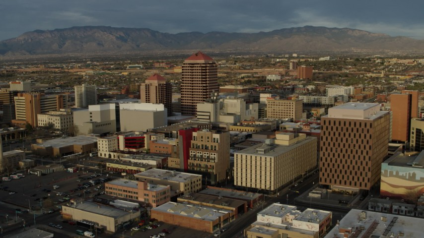 5.7K stock footage aerial video wide orbit of office high-rise and city buildings and descend, Downtown Albuquerque, New Mexico Aerial Stock Footage | DX0002_127_040