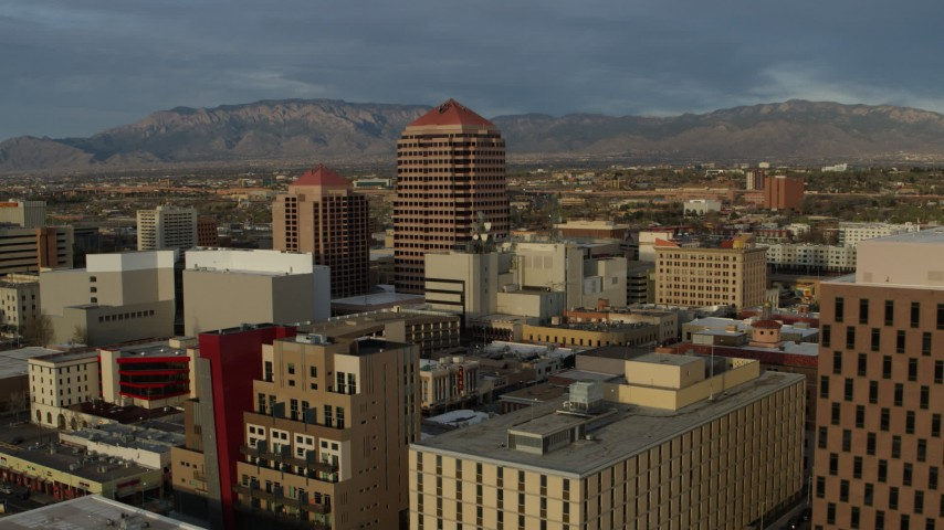 5.7K stock footage aerial video fly away from office high-rise, reveal federal building, Downtown Albuquerque, New Mexico Aerial Stock Footage | DX0002_127_043
