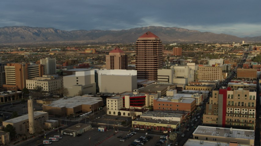 5.7K stock footage aerial video a reverse view of office high-rise at the center of city buildings, Downtown Albuquerque, New Mexico Aerial Stock Footage | DX0002_127_045