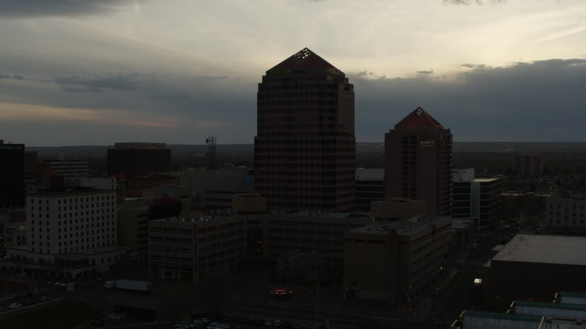 5.7K stock footage aerial video orbit office high-rise and hotel at sunset, Downtown Albuquerque, New Mexico Aerial Stock Footage | DX0002_128_001