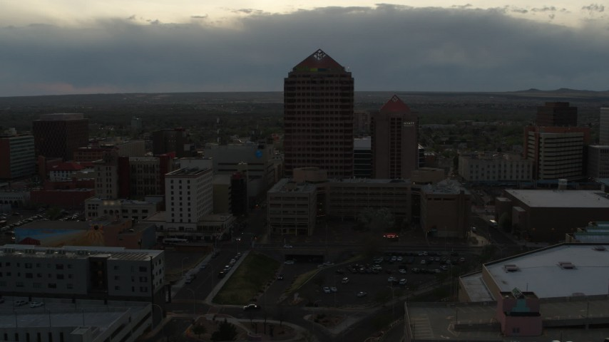5.7K stock footage aerial video of a reverse view of office high-rise and hotel at sunset, Downtown Albuquerque, New Mexico Aerial Stock Footage | DX0002_128_002