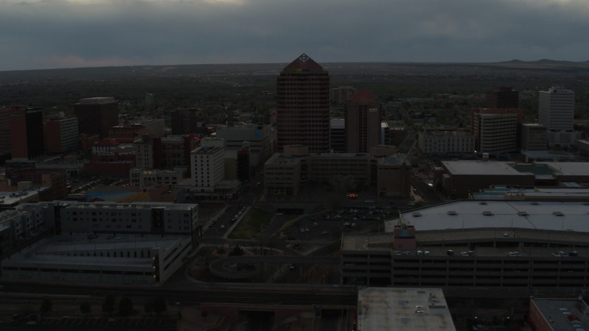 5.7K stock footage aerial video of orbiting office high-rise beside hotel at sunset, Downtown Albuquerque, New Mexico Aerial Stock Footage | DX0002_128_003