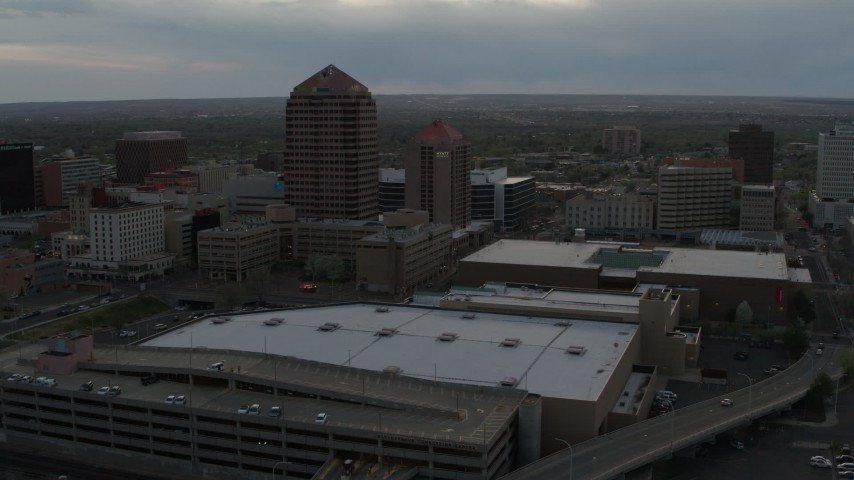 5.7K stock footage aerial video orbit office high-rise and hotel by convention center at sunset, Downtown Albuquerque, New Mexico Aerial Stock Footage | DX0002_128_004