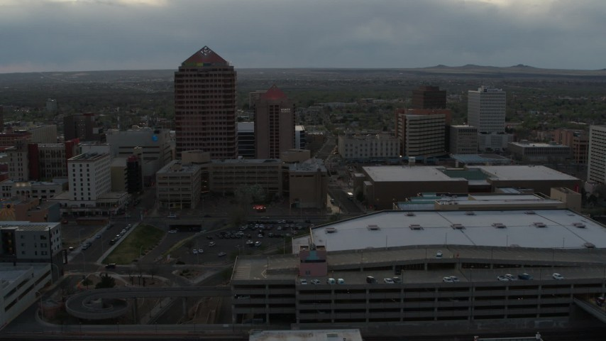 5.7K stock footage aerial video orbit around office high-rise, hotel, convention center, Kiva Auditorium at sunset, Downtown Albuquerque, New Mexico Aerial Stock Footage | DX0002_128_005