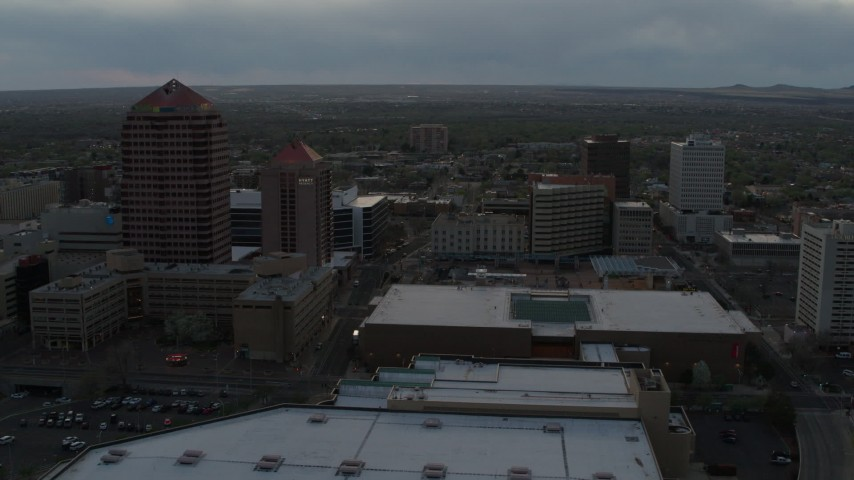 5.7K stock footage aerial video orbit office high-rise, hotel, and the Kiva Auditorium at sunset, Downtown Albuquerque, New Mexico Aerial Stock Footage | DX0002_128_006