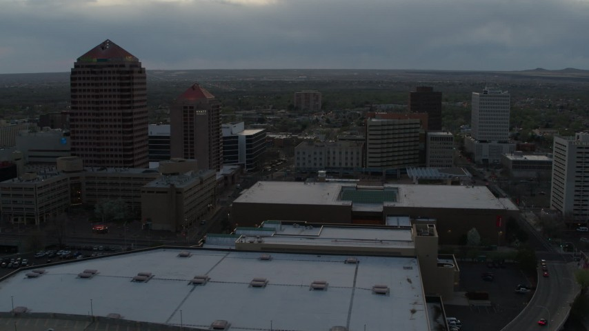 5.7K stock footage aerial video orbit office high-rise, hotel, Kiva Auditorium at sunset, Downtown Albuquerque, New Mexico Aerial Stock Footage | DX0002_128_007