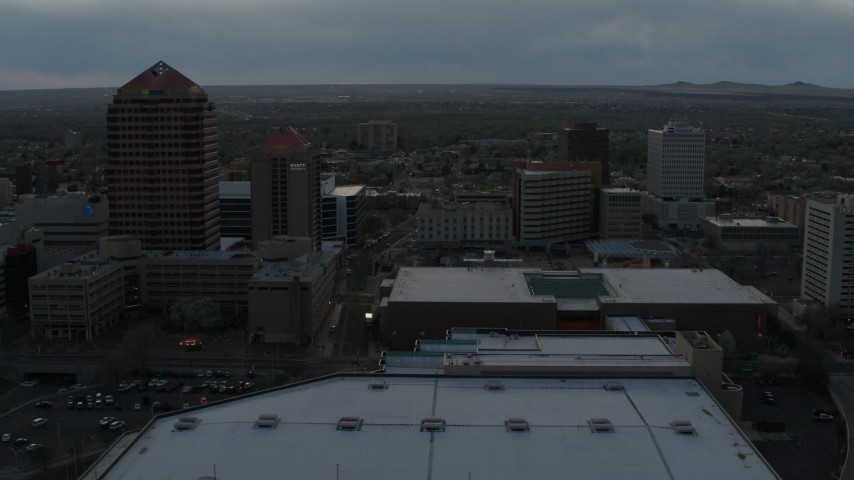 5.7K stock footage aerial video orbiting the office high-rise, hotel, Kiva Auditorium at sunset, Downtown Albuquerque, New Mexico Aerial Stock Footage | DX0002_128_008