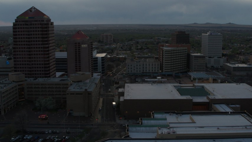 5.7K stock footage aerial video of office high-rise, hotel, and Kiva Auditorium at sunset during descent, Downtown Albuquerque, New Mexico Aerial Stock Footage | DX0002_128_009