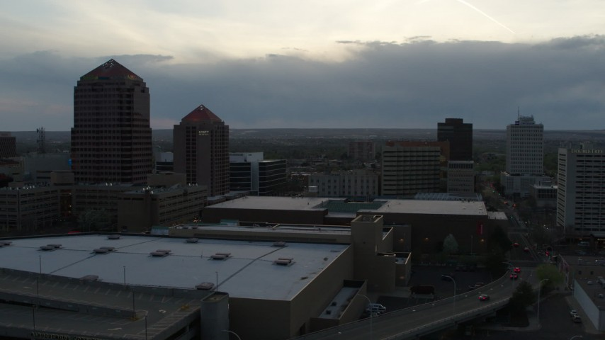 5.7K stock footage aerial video reverse view of office tower, hotel, Kiva Auditorium, convention center at sunset, Downtown Albuquerque, New Mexico Aerial Stock Footage | DX0002_128_010