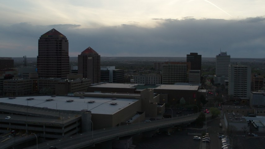 5.7K stock footage aerial video flyby office tower, hotel, Kiva Auditorium, convention center at sunset, Downtown Albuquerque, New Mexico Aerial Stock Footage | DX0002_128_011