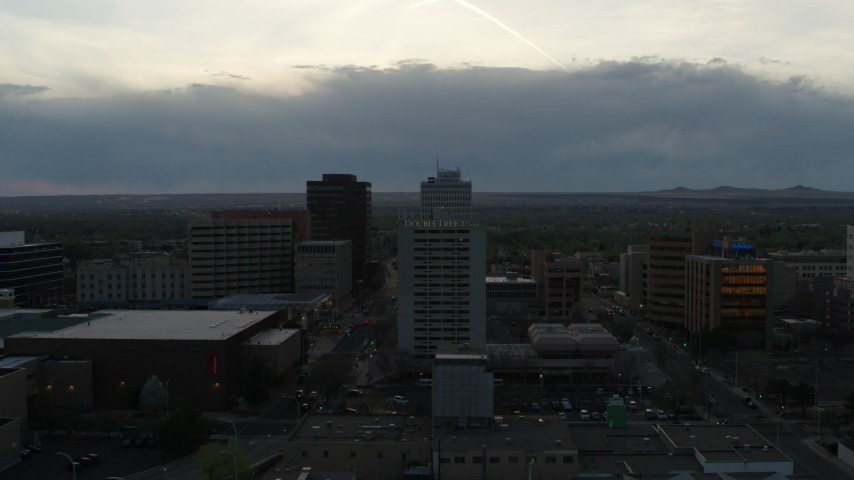 5.7K stock footage aerial video flyby Kiva Auditorium to approach hotel at sunset, Downtown Albuquerque, New Mexico Aerial Stock Footage | DX0002_128_012