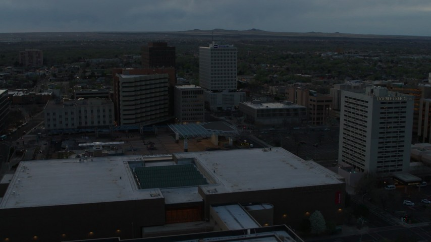 5.7K stock footage aerial video flyby hotel, office buildings, Kiva Auditorium at sunset, Downtown Albuquerque, New Mexico Aerial Stock Footage | DX0002_128_013