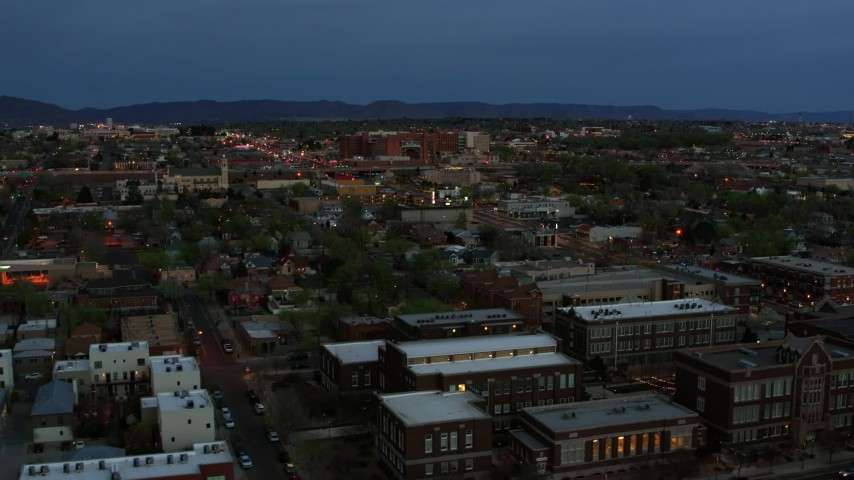 5.7K stock footage aerial video of a hospital seen from downtown at twilight, Albuquerque, New Mexico Aerial Stock Footage | DX0002_128_014