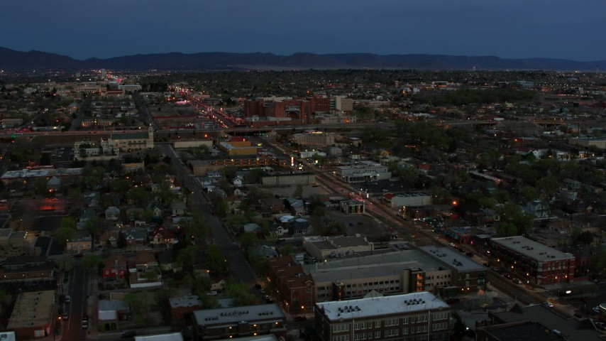 5.7K stock footage aerial video of a view of a hospital from downtown at twilight, Albuquerque, New Mexico Aerial Stock Footage | DX0002_128_015