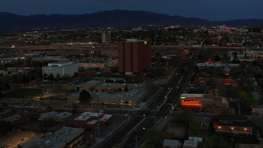 5.7K stock footage aerial video orbit around medical center at twilight, then approach, Albuquerque, New Mexico Aerial Stock Footage | DX0002_128_018