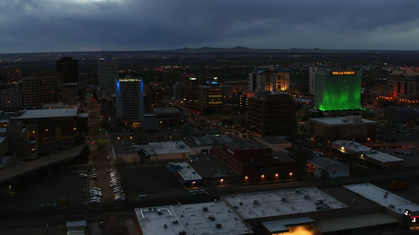 5.7K stock footage aerial video approach office buildings near hotel at twilight, Downtown Albuquerque, New Mexico Aerial Stock Footage | DX0002_128_019