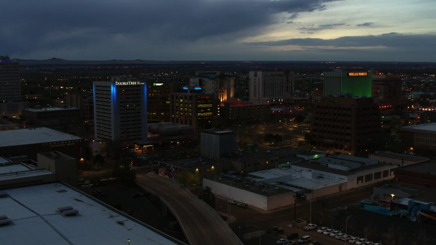 5.7K stock footage aerial video orbit and fly away from hotel and office buildings at twilight, Downtown Albuquerque, New Mexico Aerial Stock Footage | DX0002_128_021