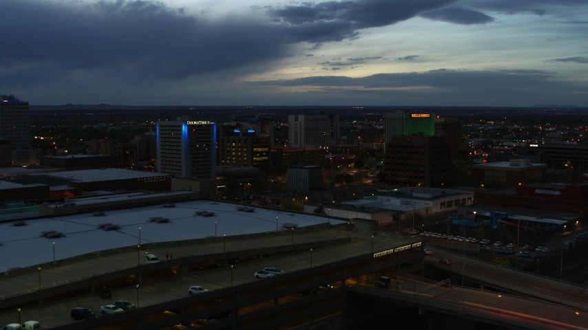 5.7K stock footage aerial video fly over convention center to approach hotel and office buildings at twilight, Downtown Albuquerque, New Mexico Aerial Stock Footage | DX0002_128_022