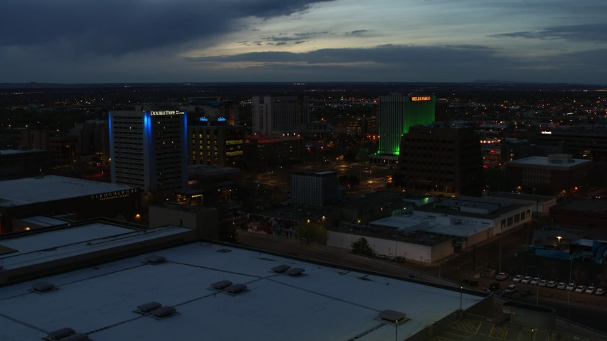 5.7K stock footage aerial video reverse view of hotel and office buildings at twilight, Downtown Albuquerque, New Mexico Aerial Stock Footage | DX0002_128_023