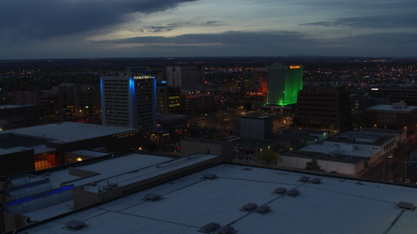 5.7K stock footage aerial video approach and flyby hotel and office buildings at twilight, Downtown Albuquerque, New Mexico Aerial Stock Footage | DX0002_128_024
