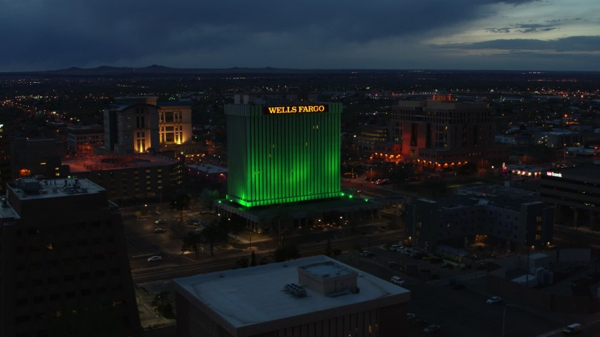 5.7K stock footage aerial video of flying by the Wells Fargo Building at twilight, Downtown Albuquerque, New Mexico Aerial Stock Footage | DX0002_128_025